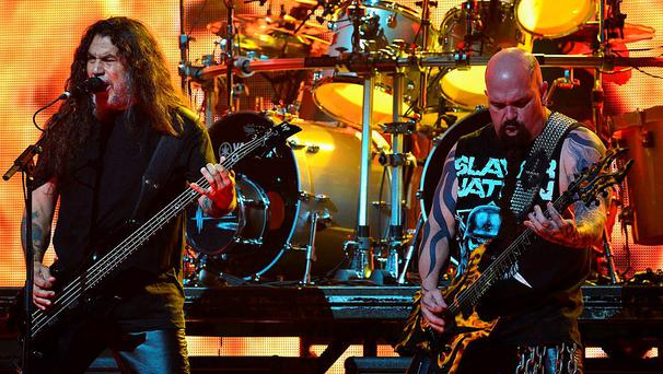 LOS ANGELES, CA - APRIL 23: Bassist Tom Araya (L) and guitarist Kerry King of Slayer performs onstage at the 2014 Revolver Golden Gods Awards at Club Nokia on April 23, 2014 in Los Angeles, California. (Photo by Frazer Harrison/Getty Images)