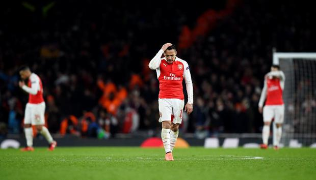 Arsenal's Alexis Sanchez looks dejected after Barcelona defeat