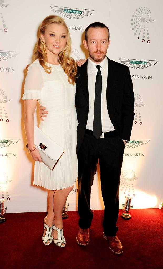 Natalie Dormer (L) and Anthony Byrne attend Aston Martin's Centenary Birthday Party, celebrating 100 years as one of the world's most iconic automotive brands, at Freemasons Hall on July 20, 2013 in London, England. (Photo by David M. Benett/Getty Images for Aston Martin)