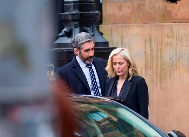 Gillian Anderson and John Lynch filming The Fall Series 3 on the streets of Belfast