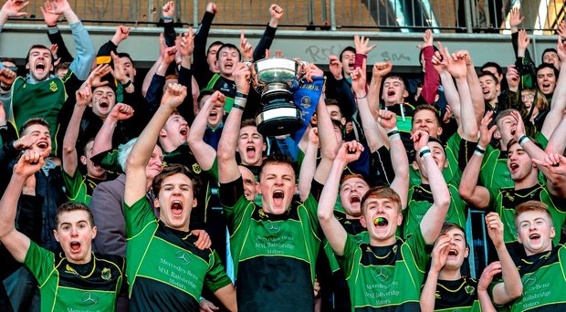 St Conleth's College captain Kevin Dolan lifts the McMullen Cup as his team-mates and supporters celebrate following their 41-0 victory over St Mary's CBS Enniscorthy at Donnybrook Stadium. Picture credit: Cody Glenn / Sportsfile.