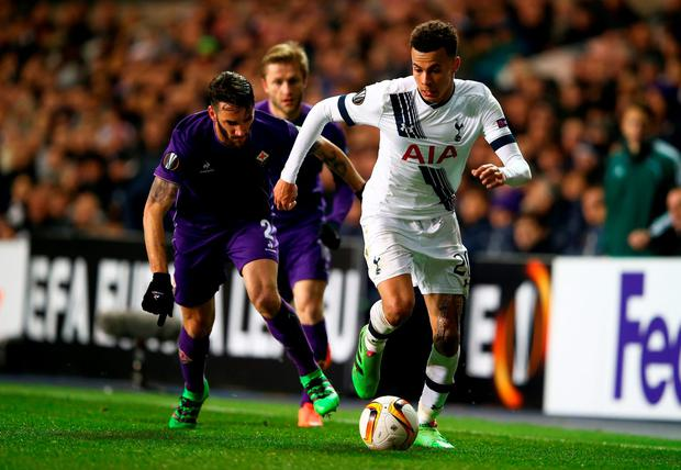 Spur star Dele Alli and Gonzalo Rodriguez of Fiorentina compete for the ball during the UEFA Europa League round of 32 second leg match at White Hart Lane. Photo: Clive Rose/Getty Images.