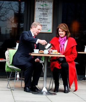 Taoiseach Enda Kenny pours a cup of tea for Tánaiste Joan Burton Photo: Tom Burke