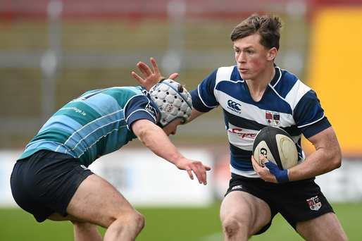 Conor Phillips, Crescent College Comprehensive, is tackled by Muiris Rowsome, Castletroy College (SPORTSFILE)