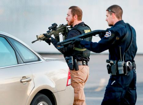 Police look for a possible second shooter in the parking lot of Excel Industries in Hesston, Kansas, where a gunman killed a number of people and injured many more. (Fernando Salazar/The Wichita Eagle via AP)
