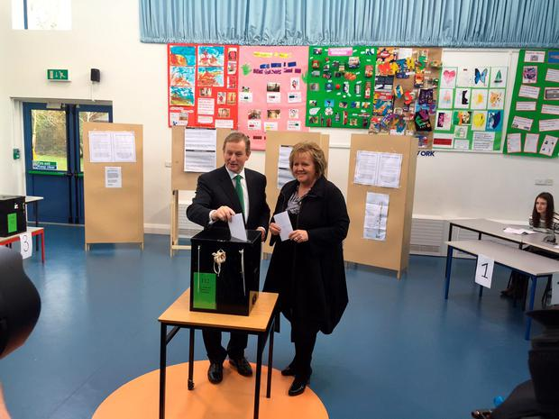 Along with his wife Fionnuala, Mr Kenny casts his ballot #GE16