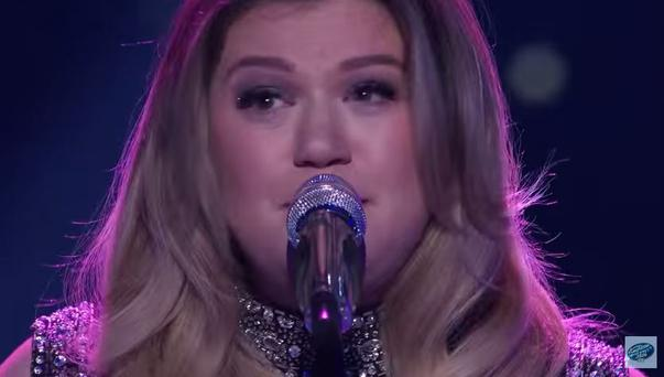 Kelly Clarkson breaks down during her performance of Piece by Piece on American Idol