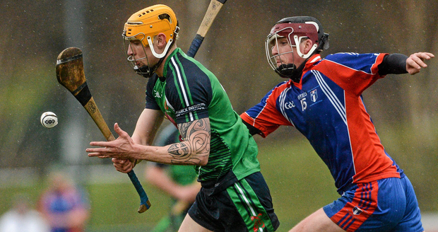 Willie Ryan, Limerick Institute of Technology, in action against Darragh Corry, Mary Immaculate College Limerick. Independent.ie Fitzgibbon Cup Semi-Final. Picture credit: Piaras Ó Mídheach / SPORTSFILE