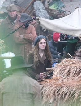 Elle Fanning is pictured filming
