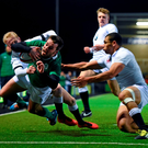 Matthew Byrne dives over to score Ireland's second try despite the efforts of England's Matthew Protheroe, left, and Joe Marchant during last night's U20s Six Nations clash at Kingston Park, Newcastle. Photo: Ramsey Cardy/Sportsfile