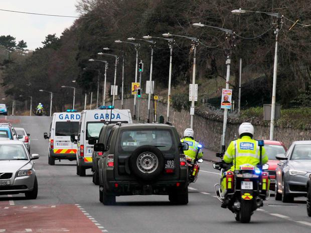 Garda outriders and two Defence Forces vehicles follow a van taking Thomas 'Slab' Murphy from court (Collins)