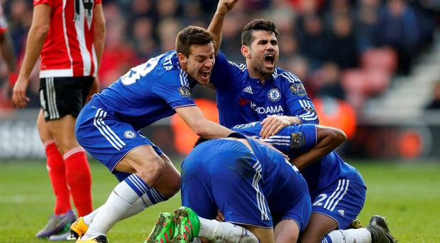 Chelsea's Diego Costa celebrates with teammates after Chelsea's Branislav Ivanovic (hidden) scores