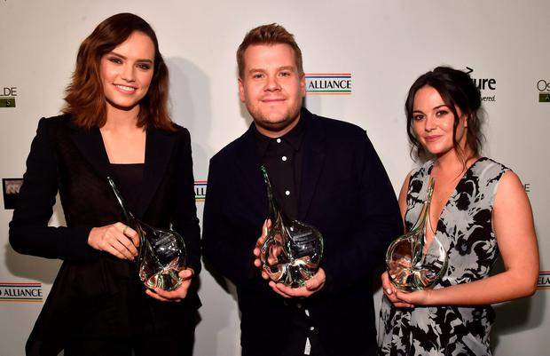 (L-R) Actors Daisy Ridley, James Corden and Sarah Greene attend the Oscar Wilde Awards at Bad Robot on February 25, 2016 in Santa Monica, California. (Photo by Alberto E. Rodriguez/Getty Images for US-Ireland Alliance)
