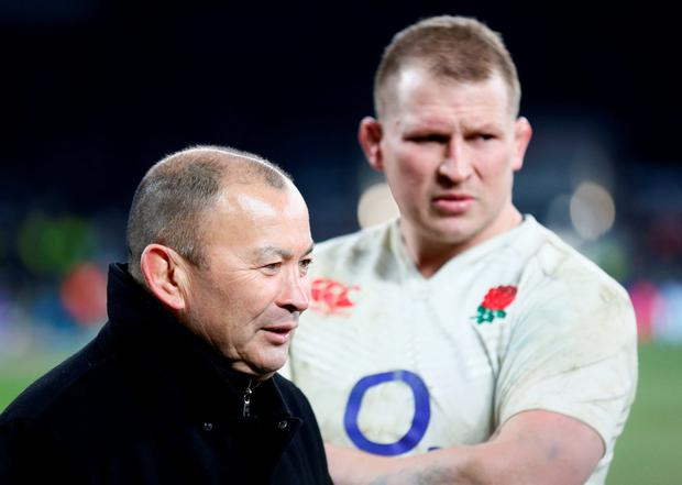 England head coach Eddie Jones and Dylan Hartley celebrate at the end of the match