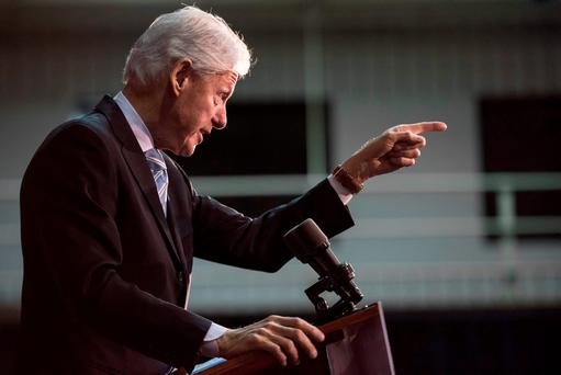 Former President Bill Clinton addresses the audience at Freedom Temple Ministry while campaigning for his wife, Democratic presidential candidate Hillary Clinton