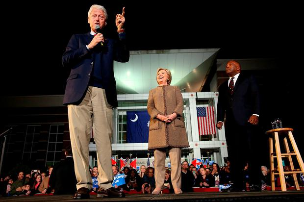 Democratic presidential candidate former Secretary of State Hillary Clinton (C) campaigns with her husband, former U.S. President Bill Clinton (L), and Columbia Mayor Stephen Benjamin (R) while attending a Get Out the Vote