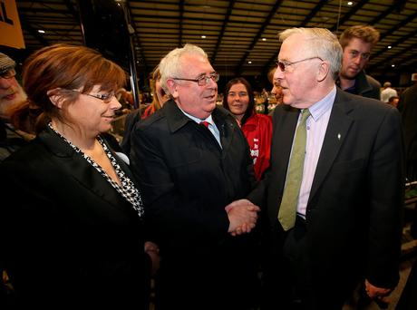 Labour's Joe Costello, with his wife Emer, shaking hands with Independent candidate Christy Burke at the RDS count centre. Credit: Damien Eagers