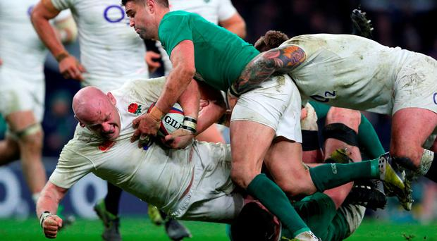 England's Dan Cole is brought down by Conor Murray and Donnacha Ryan during yesterday's Six Nations match at Twickenham. Photo: Paul Gilham