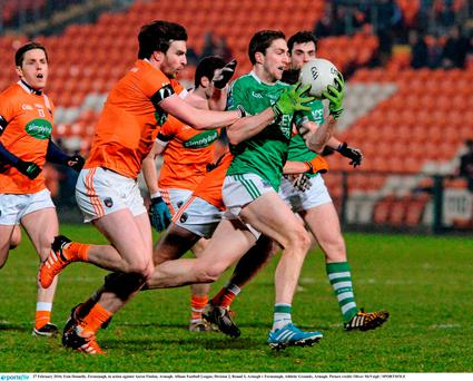 Eoin Donnelly, Fermanagh, in action against Aaron Findon, Armagh