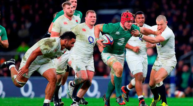 Ireland's Josh Van der Flier breaks through the tackles from Billy Vunipola and Mike Brown. Photo: Getty