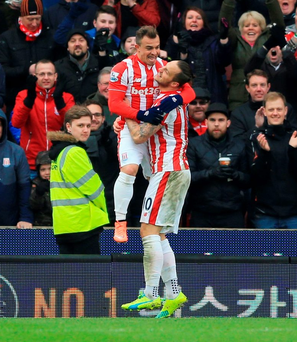 Stoke City's Marko Arnautovic (right) celebrates scoring his side's second goal of the game with Xherdan Shaqiri Photo: Nigel French/PA Wire