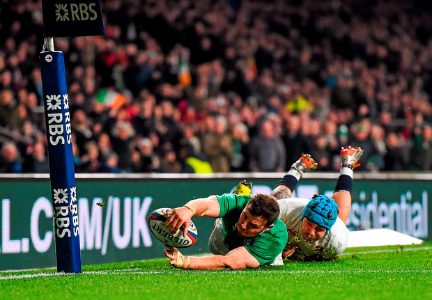 Robbie Henshaw is tackled short of the try line by Jack Nowell in Twickenham yesterday. Photo: Stephen McCarthy
