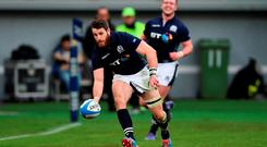 Scotland's Tommy Seymour runs in to score a try towards the end of the match. Photo: PA