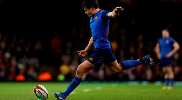 France's fly-half Francois Trinh-Duc kicks the ball to convert his team's first try during their match against Wales. Photo: Getty