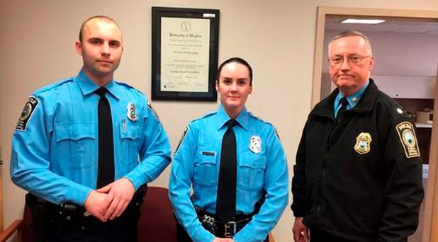 A photo provided by the Prince William County Police Department shows, from the left, Officer Steven Kendall, Officer and Ashley Guindon with Lt. Col. Barry Bernard, deputy chief of the Prince William County, Va., Police Department. (Prince William County Police Department via AP)