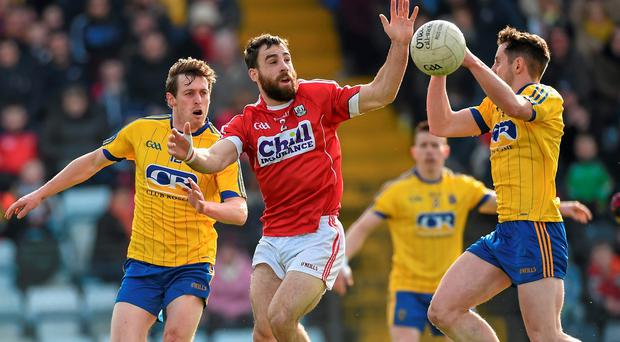 Colm O'Driscoll, Cork, in action against Conor Devaney, left, and Ciaran Murtagh, Roscommon