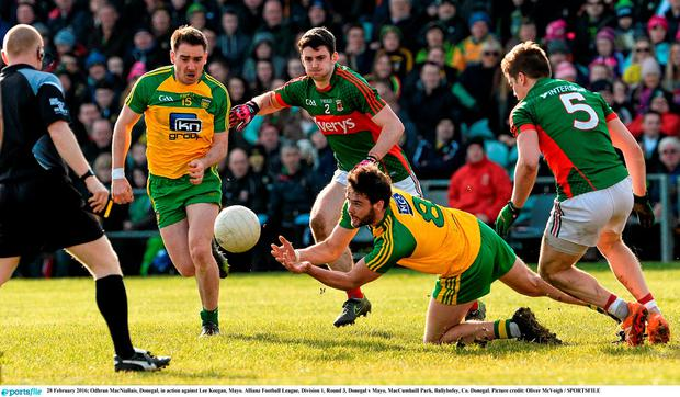 Odhran MacNiallais, Donegal, in action against Lee Keegan, Mayo