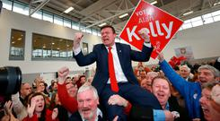 Labour's Alan Kelly celebrates with his supporters at the count centre in Thurles, after he won the last seat in the Tipperary Constituency