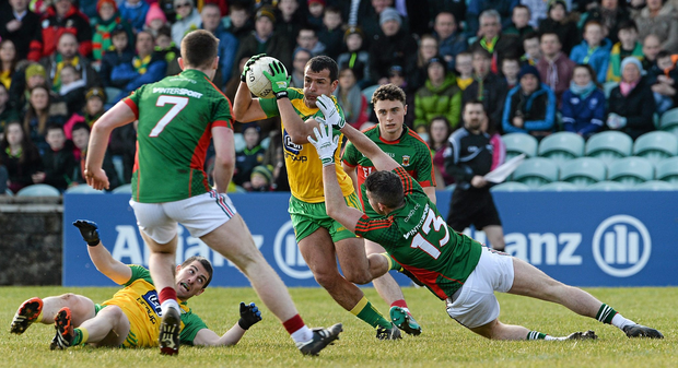 28 February 2016; Frank McGlynn, Donegal, in action against Evan Regan, Mayo. Allianz Football League, Division 1, Round 3, Donegal v Mayo, MacCumhaill Park, Ballybofey, Co. Donegal. Picture credit: Oliver McVeigh / SPORTSFILE
