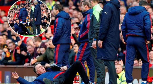 Louis van Gaal takes a tumble