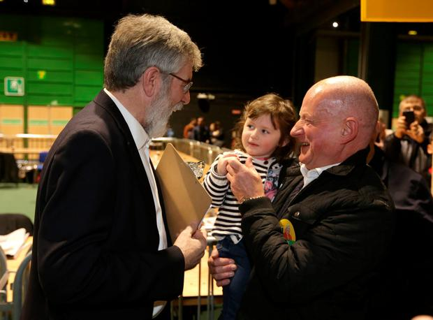 Sein Fein leader, Gerry Adams meets Paul Bizzell, and his granddaughter, aiobheann, 3 at the RDS count centre. Picture credit; Damien Eagers 26/2/2016