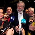Sein Fein deputy leader, Mary Lou McDonald, Sein Fein leader, Gerry Adams and Denise Mitchell, candidate in Dublin bay north speak to journalists at the RDS count centre. Picture credit; Damien Eagers 26/2/2016