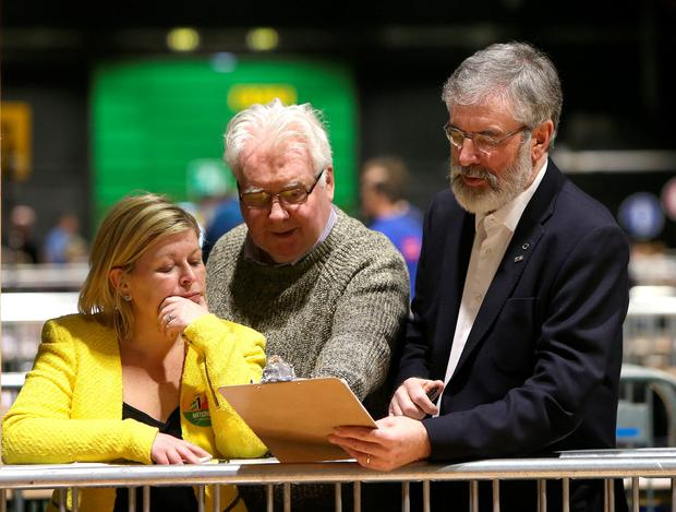 Sein Fein leader, Gerry Adams with Denise Mitchell, candidate in Dublin bay north and clr, Larry O'Toole checking the voting numbers at the RDS count centre. Picture credit; Damien Eagers 26/2/2016