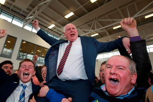Fianna Fail's Jackie Cahill celebrates with his supporters Credit : Frank Mc Grath