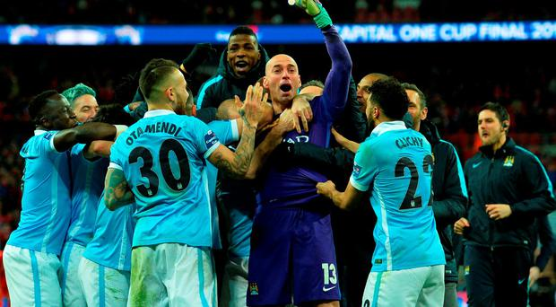 Manchester CIty's Argentinian goalkeeper Willy Caballero (C) celebrates with his team-mates
