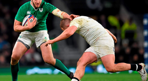 Ireland's Stuart McCloskey is tackled by England's Dylan Hartley during their Six Nations clash at Twickenham