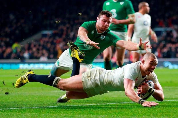 England's Mike Brown scores his side's second try of the game during the Six Nations clash with Ireland at Twickenham. Photo: David Davies/PA