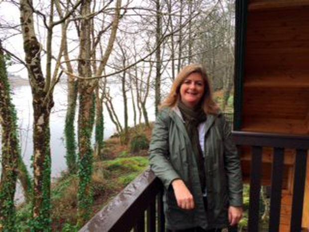 Lady of the lake: Madeleine relaxes on the balcony of her wooden lodge at Lusty Beg Island Resort overlooking the lapping waters of Lough Erne