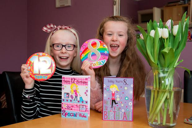 Leap year sisters Lana (12) and Robyn (8) McKeon celebrate their birthdays at their home in Blanchardstown, Dublin. Because they were born on February 29, this is technically the girls' third and second birthdays. Photo: Colin O'Riordan