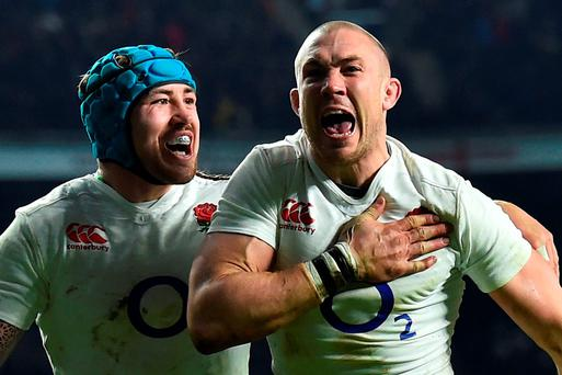 England full-back Mike Brown celebrates scoring his second-half try alongside team-mate Mike Nowell (left), but Brown's subsequent use of the boot which saw Conor Murray go off injured was the subject of much debate. Photo: Ben Stansall/AFP/Getty Images
