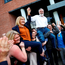 Sinn Féin president Gerry Adams and councillor Imelda Munster are lifted by supporters after being elected. Photo: Reuters