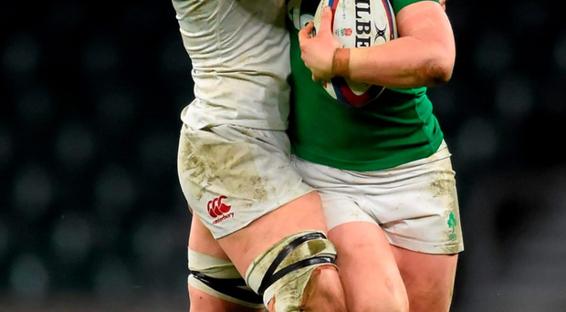 Ireland's Cliodhna Moloney hands off England's Sarah Hunter during Saturday's Women's Six Nations clash at Twickenham. Photo: Stephen McCarthy/Sportsfile