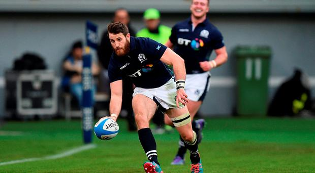 Scotland's Tommy Seymour runs in to score a try towards the end of the Six Nations match at the Stadio Olimpico in Rome. Photo: Andrew Matthews/PA