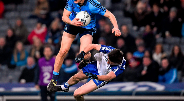 Dublin's Michael Fitzsimons collides with Monaghan's Shane Carey during Saturday's Allianz NFL Division 1 clash at Croke Park. Photo: Ray McManus/Sportsfile