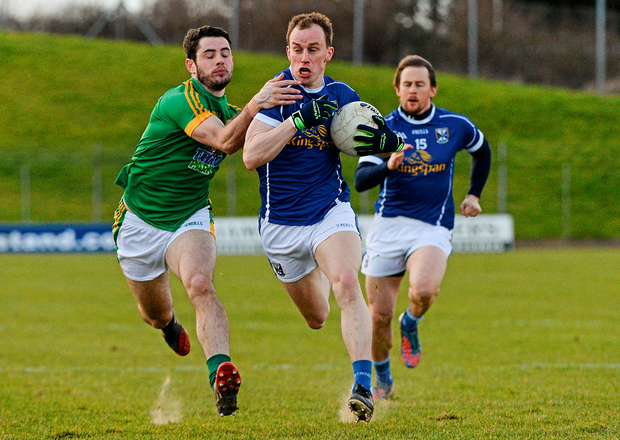 Martin Reilly, Cavan, in action against Donal Keoghan, Meath. Photo: Dean Cullen/Sportsfile