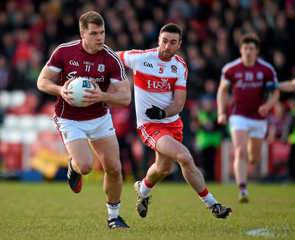 Eddie Hoare, Galway, in action against Mark Craig, Derry. Photo: Philip Fitzpatrick/Sportsfile
